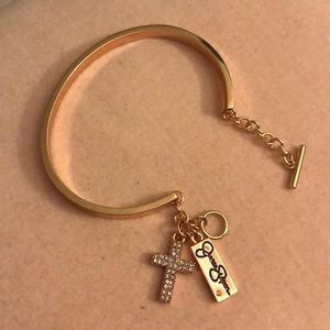 Jessica Simpson rose gold cross & blessed bangle.